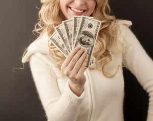 Girl holding 500 dollars