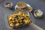 An Indian dish consisting of cauliflower and spinach