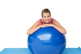 Portrait of a fit smiling woman with fitness ball
