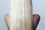 Blond Hair.Back side of Young Woman with Straight Hair.Abstract
