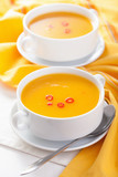 pumpkin soup in white bowl