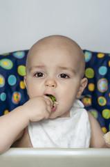 Baby boy eating vegetables