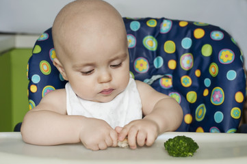 Baby boy eating vegetables