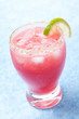 glass of watermelon cocktail with brown sugar and lime