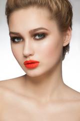 Woman with orange lipstick