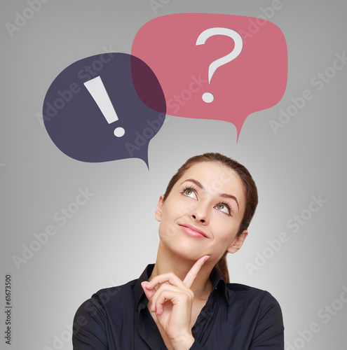 Thinking woman looking on question and exclamation above on grey