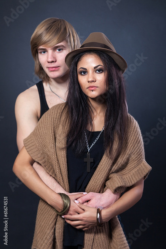 Portrait of happy young couple hugging
