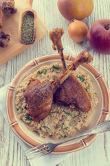 roasted goose thighs with grits - retro vintage