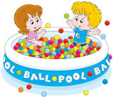 Little girl and boy playing in a ball pool