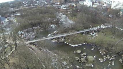 Small river bridge in city . Aerial
