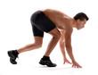 Atleta corredor en posición de partida.