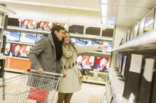 canvas print picture Young couple shopping electronics