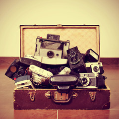 old cameras in an old suitcase
