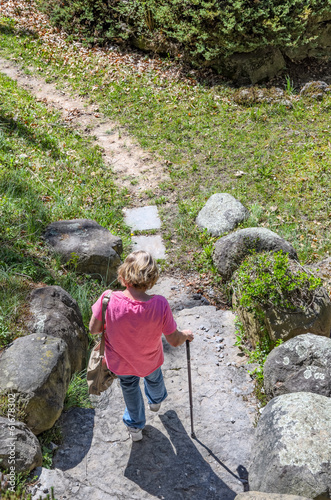 Woman with Cane Walking on Path