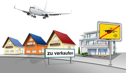 Fluglärm über Wohnsiedlung