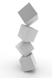 selection of cubes balancing on top of one another