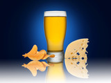 Glass of beer with crisps and cheese on a blue background