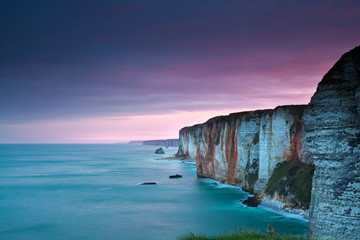 purple sunrise over Atlantic ocean and cliffs