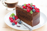 Sacher cake on a plate with berries