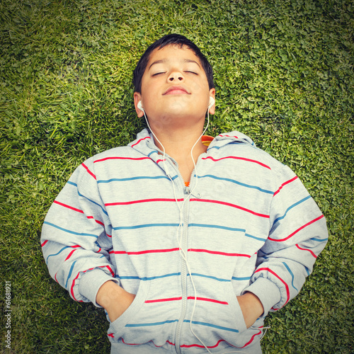 little boy lying on the grass