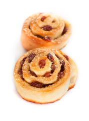 Two swirl buns with raisins and brown sugar