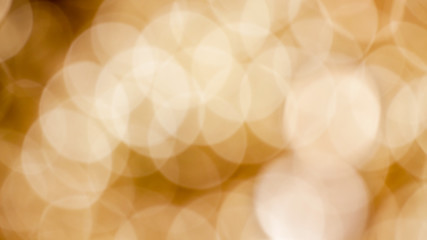 Bokeh background with defocused golden lights