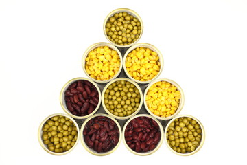 The tins with peas, red bean, corn on the white background