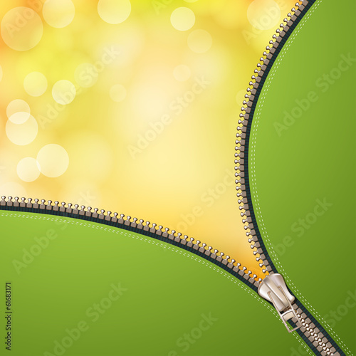 Opened metallic zipper over yellow background