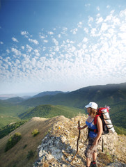 The magnificent landscape opens to a woman who stands on the top
