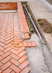 Orange brick paving stones in construction process