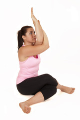 Yoga model in shoulder stretching cow face with eagle arm bind
