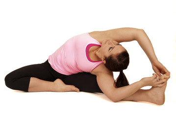Yoga instructor in seated side stretch pose Parsva Upavista Kona