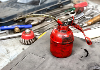 oil can on workbench with tools