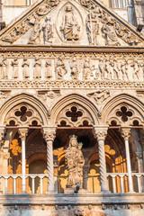 Ferrara, ITALY -  Part of facade of Cathedral sculpture