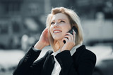 Young business woman calling on the cell phone outdoor