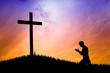 man praying under the cross - 61687178