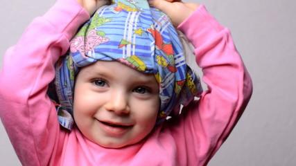 Little Girl Hiding Face in a Dress, Closeup