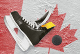 Puck, skates and Canadian flag