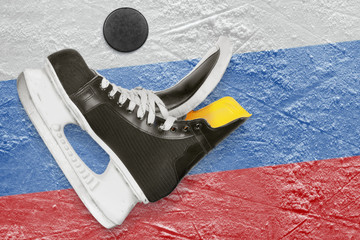 Puck, skates and the Russian flag