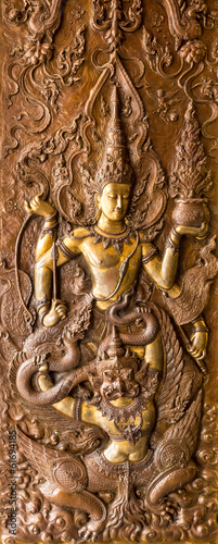 Thai art stucco on the wall of church(Narayana on Garuda)