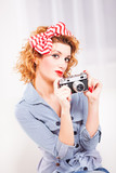 Portrait of elegant retro style woman with camera.