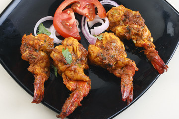 Tawa Prawn – Goan dish made of prawns skewered and cooked on taw