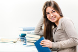 Portrait of Cute Young woman with many books.