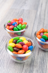 Three glass bowls with crunchy sweeties