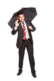 smiling businessman with umbrella