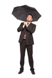 surprised businessman with umbrella
