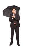 elegant man looking up with umbrella