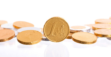 Euro currency, chocolate coins isolated on white