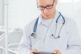Doctor with a tablet PC