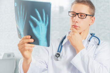 Physician looks at x-ray image